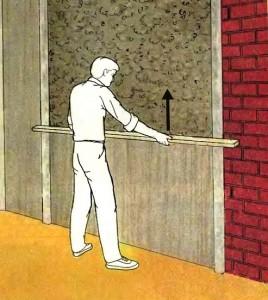 Нанесение раствора на стену